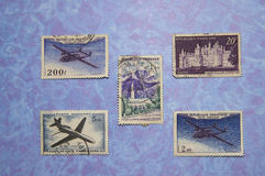 French Stamps. Arrangement of 5 French stamps on a watery blue background