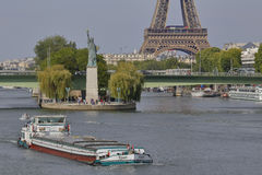 French Statue of Liberty Replica and Eiffel Tower, view from the River Seine - Paris, France, AUGUST 1, 2015 - was given to Citize Stock Photo
