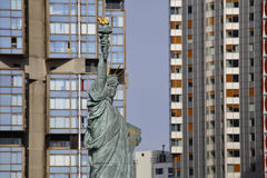French Statue of Liberty Replica and modern buildings, Paris, France, AUGUST 1, 2015 - was given to Citizens of Paris in July 4, 1 Stock Photos