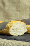 French stick bread cutting Stock Images