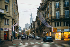 French street with Christmas Decortions and Notre-Dame Cathedral. STRASBOURG, FRANCE - DEC 20, 2016: French street with Christmas Decortions and Notre-Dame Stock Image