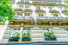 French street in Paris. With amazing plats during daytime Stock Images