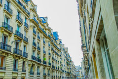 French street in Paris. With amazing plats during daytime Royalty Free Stock Image