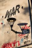 French streetlamp with graffiti war stock photography