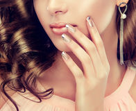 French-style manicure. Close-up image silver colored lips and french-style manicure stock image