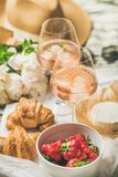 French style romantic summer picnic setting with rose wine. French style romantic summer picnic setting. Flat-lay of glasses of rose wine with ice, fresh Stock Photography