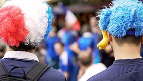 French supporters in funny hats with mascots supporting national soccer team stock photos