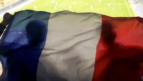 French supporters waving national flag, cheering for football team victory. Stock photo royalty free stock photos