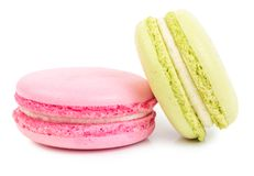 A french sweet delicacy macaroons isolated. A french sweet delicacy, macaroons variety closeup. Isolated on white background Stock Photo
