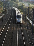 French TGV  full speed on bright day. French TGV fast train go to north on a bright day Stock Images
