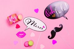 French theme photo props - lips, mustaches, gift box and macaroons on pink Valentines day background Stock Images