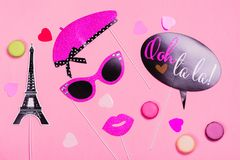 French theme photo props - lips, mustaches, gift box and macaroons on pink Valentines day background Royalty Free Stock Photos