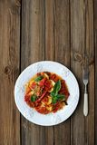 French tian with tomato, zuccini and aubergine garnished with fr. Esh basil Royalty Free Stock Image