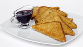 French toast. Plate of french toast and a berry sauce royalty free stock image