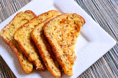 French Toast. Perfectly cooked, on a square white plate royalty free stock photography
