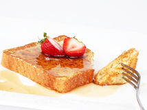French toast. With syrup and strawberries Royalty Free Stock Photography