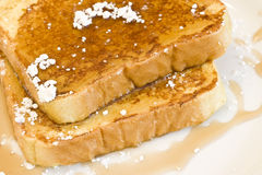 French toast. On a white plate with powdered sugar and maple syrup royalty free stock images