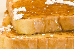 French toast. On a white plate with powdered sugar and maple syrup Royalty Free Stock Photo