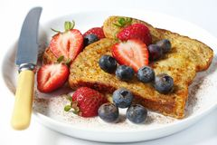 French Toast. With strawberries, blueberries, and cinnamon.  A delicious, healthy breakfast Royalty Free Stock Images