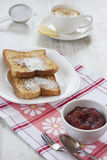 French toast and apple jam. Breakfast with french toast, apple jam and tea with lemon stock photography