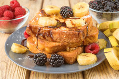 French toast with banana and berries Stock Photos