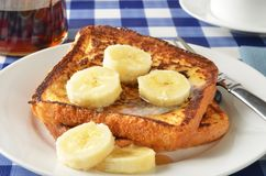 French toast with bananas. Closeup of french toast on a picnic table with sliced bananas Royalty Free Stock Photos