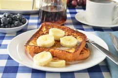 French toast with bananas. French toast with sliced bananas on a picnic table Stock Images