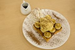 Nutella banana French Toast with ice-cream, sprinkle with cocoa powder stock photography