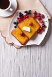 French toast with berries and coffee on the table. vertical top Stock Photo