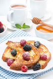 French toast with berries and powdered sugar for breakfast Royalty Free Stock Images