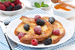 French toast with berries and powdered sugar Royalty Free Stock Photos