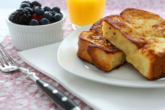 French toast. With blueberries and butter stock images