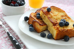 French toast. With blueberries and butter royalty free stock images