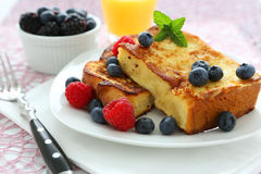 French toast. With blueberries and butter royalty free stock image