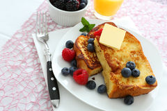 French toast. With blueberries and butter royalty free stock photos