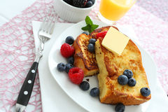 French toast. With blueberries and butter royalty free stock photography