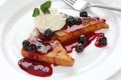 French toast with blueberry sauce Stock Images