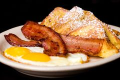French Toast Breakfast. French Toast, eggs and bacon for breakfast Stock Photos