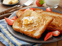French toast with butter and honey Royalty Free Stock Photography
