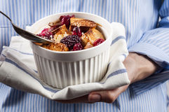 French toast casserole with berries in female hands Royalty Free Stock Images