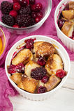 French toast casserole with cranberries, raspberries and blackbe Royalty Free Stock Photography