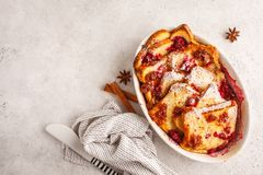 French toast casserole with raspberries, powdered sugar and cinnamon, copy space.