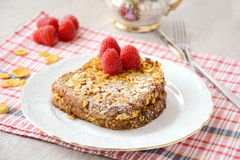French toast with cornflakes and raspberries Royalty Free Stock Images