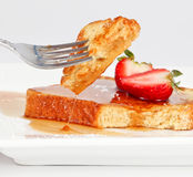 French toast drip. French toast with drip of syrup and strawberries isolated on white background Royalty Free Stock Image