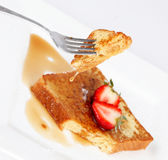 French toast with drip of syrup  and strawberries Stock Photos