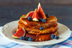 French toast with fig. Homemade rustic french toast with fig, honey and blueberries Royalty Free Stock Images
