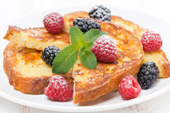 French toast with fresh berries, mint and powdered sugar Stock Photo