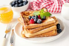 French toast with fresh berries and honey stock photos
