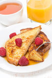 French toast with fresh raspberries and maple syrup. Vertical Stock Images