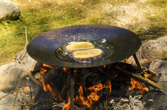 French toast fried on a camp fire. French toast cooked on a camp fire in the pine forest royalty free stock image